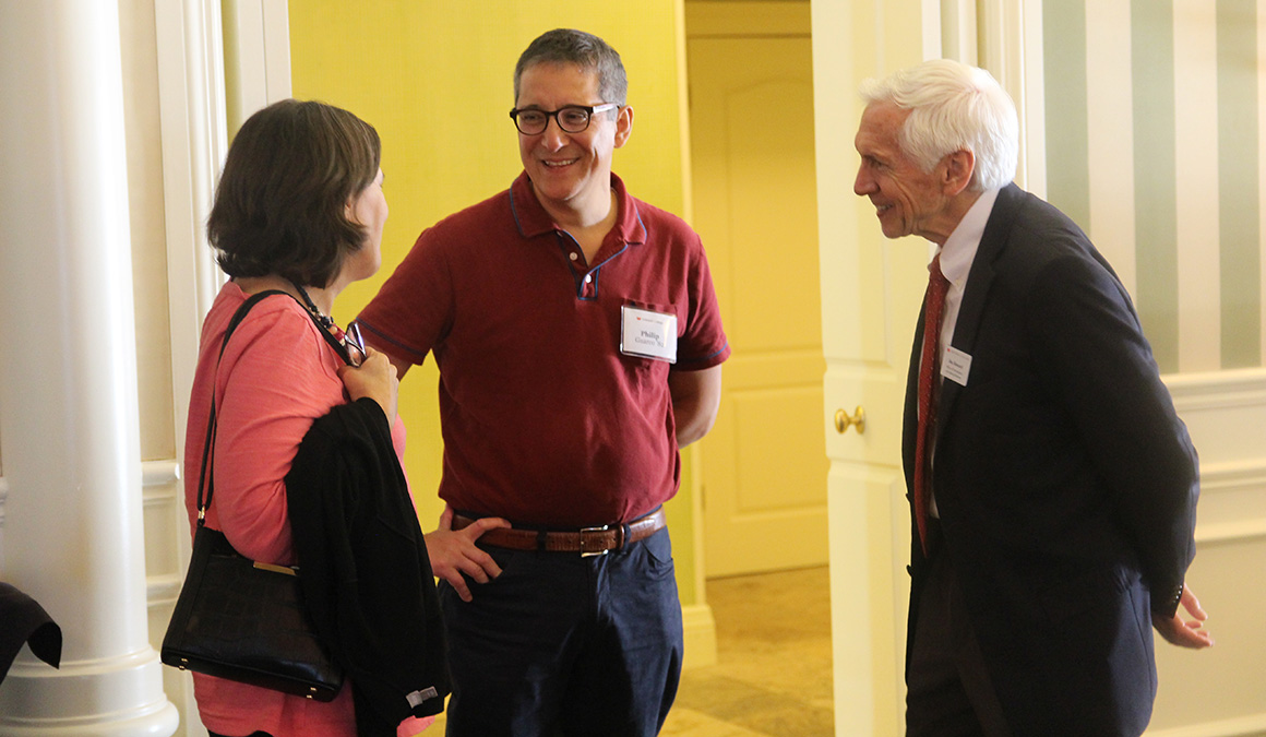 Kate Jackson '83, left, and Phil Guarco '82 talk with Jim Howard, Grinnell College director of principal gifts, at a Campaign for Grinnell College event in Naples, Florida.