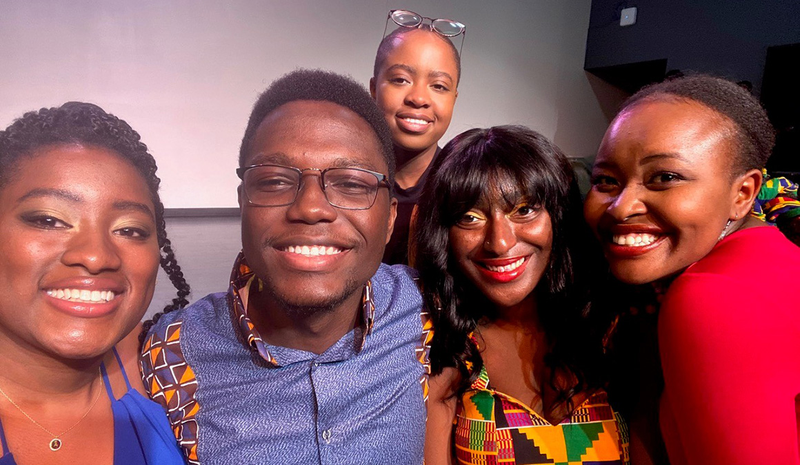 Essilfie, second from left, and other leaders of the African and Caribbean Students Union pose for a photo during a pre-pandemic event.