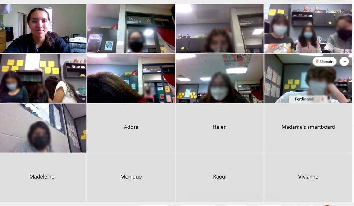 A screenshot from earlier this year shows Mercedes Varela '21, top left, visiting with high school students who were taking a French class taught by Mary Parker '06.
